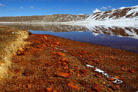 Mining contamination in Laguna Milluni after fresh snowfall, Cordillera Real, Bolivia
