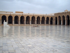 Looking across the marble courtyard of the Grand Mosque,  Kairouan, Tunisia; Landscape