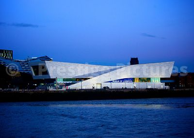The modern Architecture of The Museum of Liverpool at dusk, viewed across the Mersey River