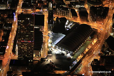 night aerial photograph of the Beetham Tower / Hilton Hotel and the GMEX /  Manchester Central Convention Complex Manchester