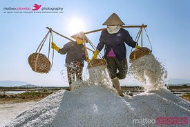 Vietnam, Nha Trang. Doc Let. Vietnamese women working in the salt fields (MR)