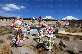 Grave of Bolivian immigrant in Caquena cemetery, Payachatas volcanos in background, Region XV, Chile