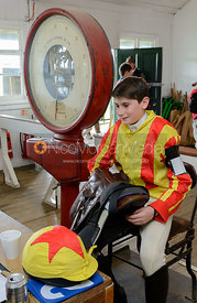 Pony racing jockeys on the scales in the weighing room