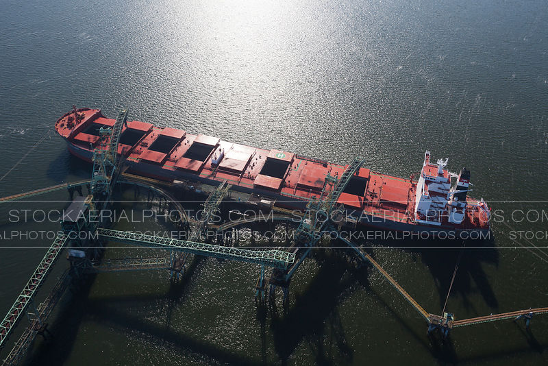 Cargo Ship Being Loaded with Coal