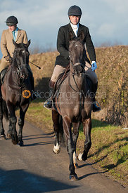 Members of the Cottesmore Hunt field arrive for the meet.