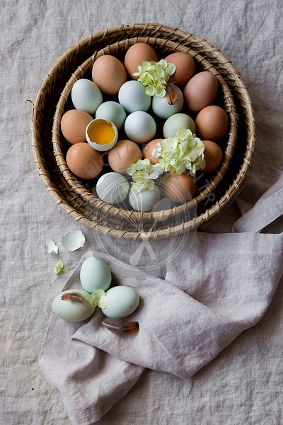 Multicoloured eggs in a basket