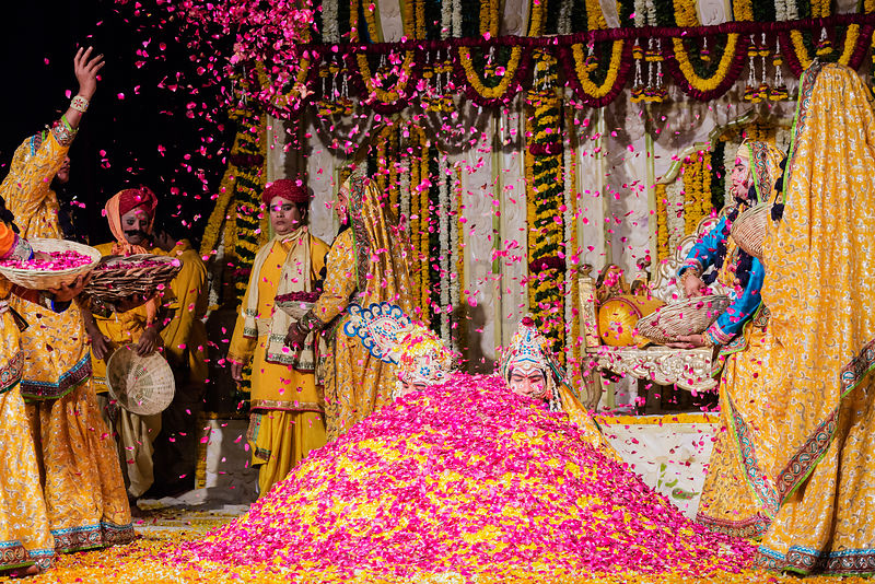 Krishna and his Wife Radha get buried in petals during a flower Holi