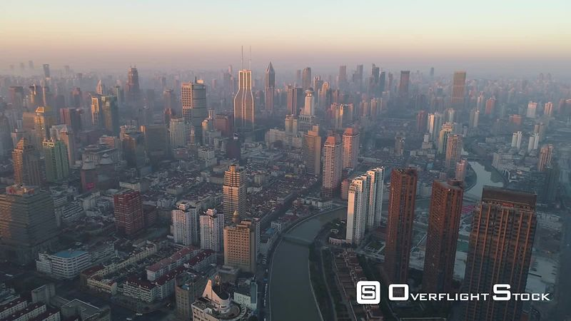 Shanghai Skyline in the Sunny Morning. Puxi District. China. Aerial View. Drone is Flying Forward. Establishing Shot.