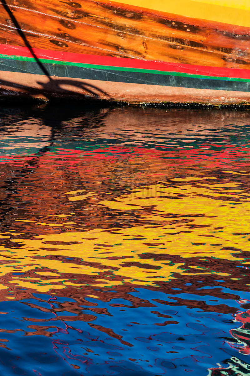 Colorful Fishing Boat Reflected in Harbour