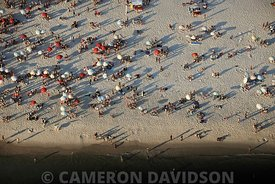 Aerial of beach and coastline of Rio de Janeiro, Brazil along Avenue Lucio Costa.