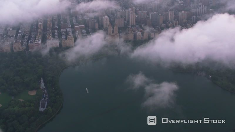New York City Aerial view of Central Park and Manhattan through clouds.  Shot with Cineflex and RED EpicW Helium.