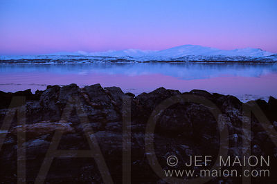 Twilight on snow-capped mountains and fjord