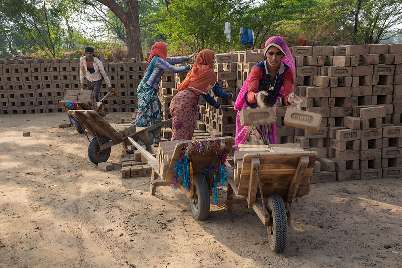 Brick Workers Loading Dried Bricks to be Taken to the Firing Kilns