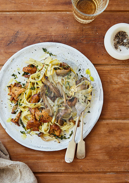 Wild mushroom tagliatelle on wooden table