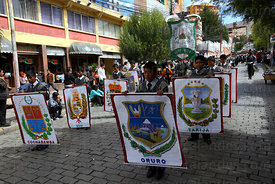 College group parades through streets holding badges of Bolivia's Departments for Dia del Mar / Day of the Sea , La Paz , Bolivia