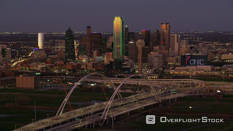 Dallas, Texas Aerial view of Margaret McDermott arch bridge and city at dusk