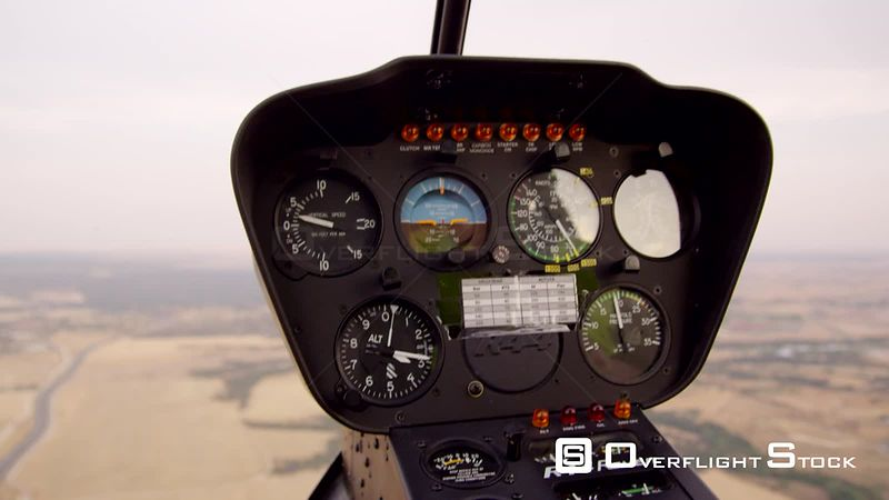 CU helicopter instrument panel during practice autorotation descent, RED R3D 4K