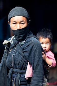 Portrait of woman and baby from rare Dan Toc La Chi tribe
