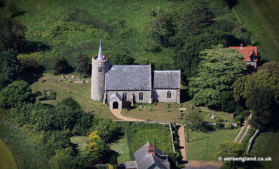 aerial photograph of St Mary's church Tichwell Norfolk England UK