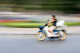 Motor cyclist riding motorcycle fast