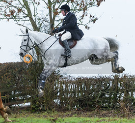 Richard Hunnisett jumping a hedge above Withcote