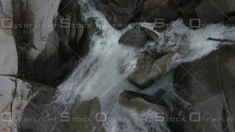 Whitewater Stream Winding and Eroding Rock in Fork River