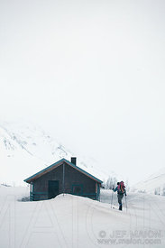 Skier approach wilderness hut