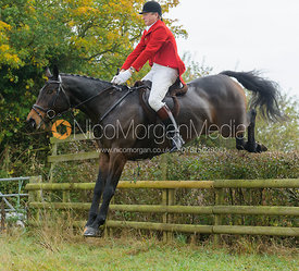 Nicholas Leeming jumping a hedge near Wilson's - The Cottesmore at Langham.