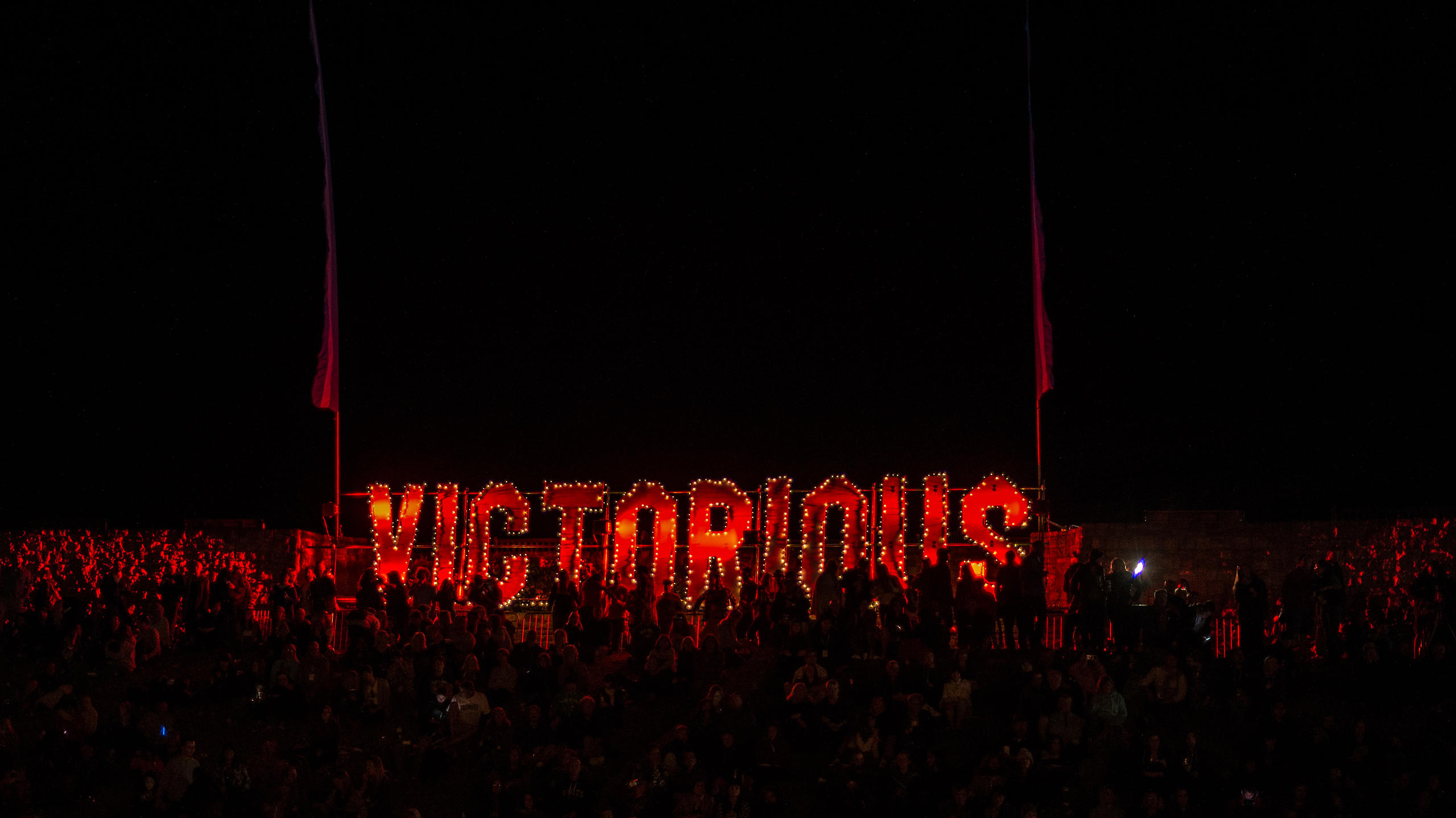 Victorious Festival Neon Sign over Crowds