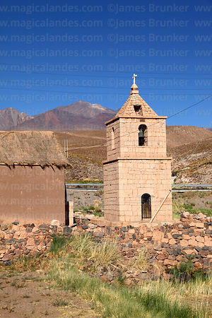 Old church belfry and Cerro Lejia volcano, Socaire, Region II, Chile
