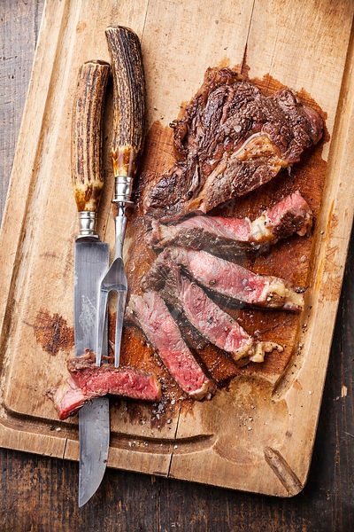 the picture pantry food stock photo library medium rare grilled beef steak ribeye with knife. Black Bedroom Furniture Sets. Home Design Ideas