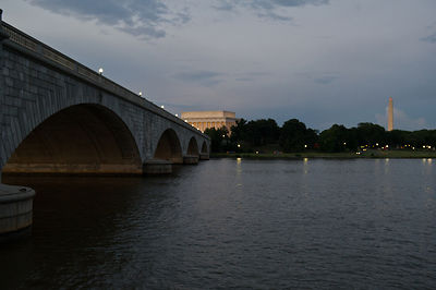 Arlington Memorial Bridge and the Lincoln Memorial and Washington Monument seen from a Potomac River cruise in Washington DC.