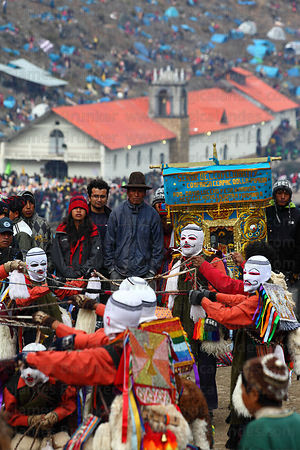 Kapac Qolla / Pablitos dancers on hillside above Sanctuary in morning mist during Qoyllur Riti festival, Peru