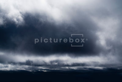 An atmospheric image of a cloudy, black, stormy sky.
