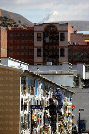 People preparing tombs in cemetery for Todos Santos festival, La Paz, Bolivia