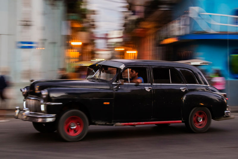 Vintage American Car in Havana Street at Dusk