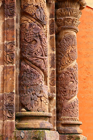 Detail of lion, bird and grape carvings on pillars of main side entrance facade of St John the Baptist of Letrán / San Juan Bautista de Letrán church, Juli, Puno Region, Peru