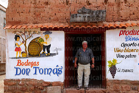 Don Tomas in the doorway of his bodega Don Tomas wine shop, Villa Abecia, Chuquisaca Department, Bolivia