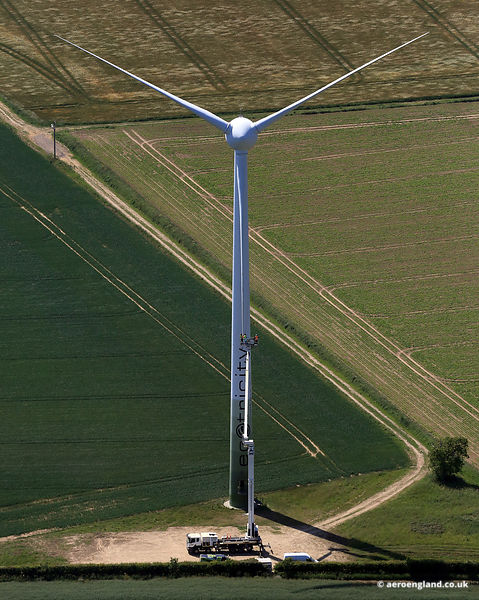 Workers working on a Wind Turbine using a boom lift in Norfolk UK