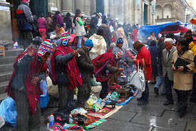 Yatiris or shamans tout for business on steps outside the cathedral, Alasitas festival, La Paz, Bolivia