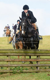 adrienne Collie jumping a hunt jump at Burrough House - The Cottesmore at Somerby 5/11
