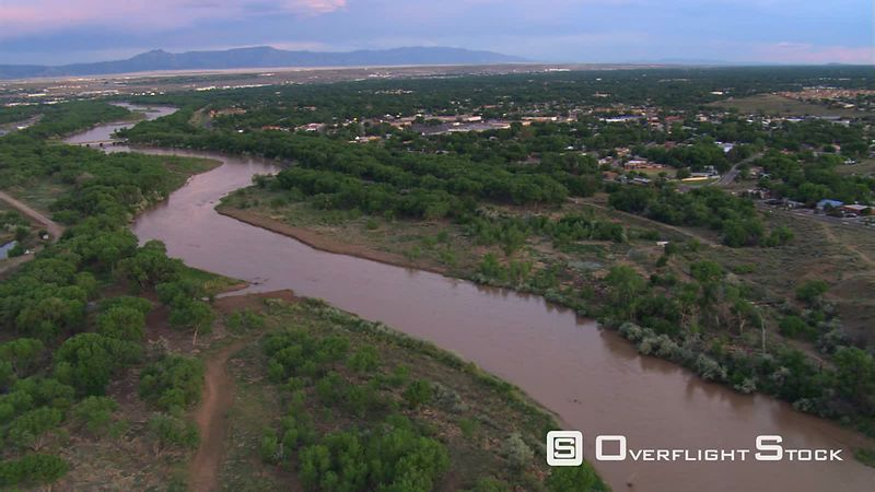 Flying above muddy Rio Grande toward Albuquerque and I-40 bridge.