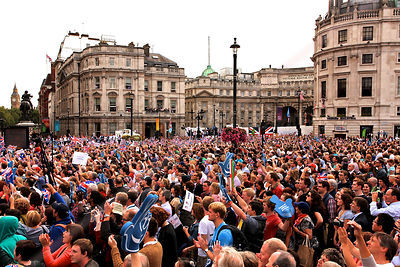 Crowds Mass in Trafalgar Square to get a Glimpse of the Athletes Parade