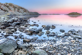 Rocky winter shore at early dawn