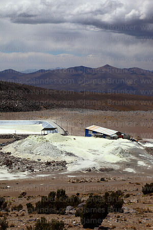 Final evaporation basin (part of the Capurata mining project to extract sulphur) and dried sulphur compounds on flanks of Acotango volcano, Oruro Department, Bolivia