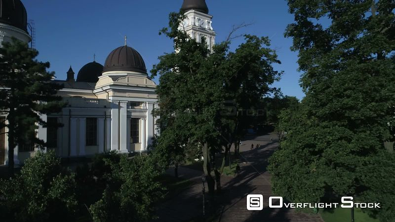 Drone camera flies slowly up from Saborna Square to reveal Preobrazhensky Cathedral in Odessa Ukraine. Taken on a crystal clear summer morning
