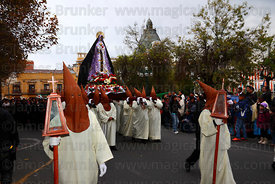 Penitents carrying statue of Virgen de los Dolores / Virgin of Sorrows during Good Friday procession, Plaza Murillo, La Paz, Bolivia