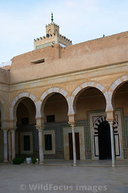The colonade of the Mosque of the Barber. It is know as this becasue the complex contains the tomb of Abu Zama el-Belaoui, a companion of the Prophet Mohammed. He was known as the barber because it is said he always carried 3 hairs from the Prophet's beard. Kairouan, Tunisia; Portrait