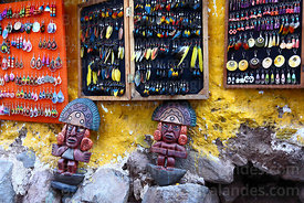 Feather earrings and ceramic tumis for sale at Pisac market, Sacred Valley, Peru