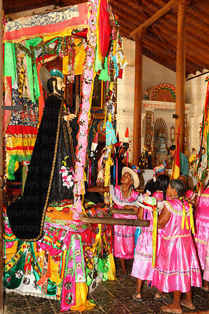 Abadesas praying to figure of San Ignacio in Jesuit Mission church after mass, San Ignacio de Moxos, Bolivia